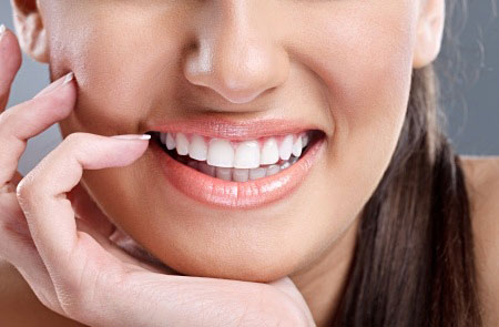 How Teeth Whitening Can Improve A Faded Smile